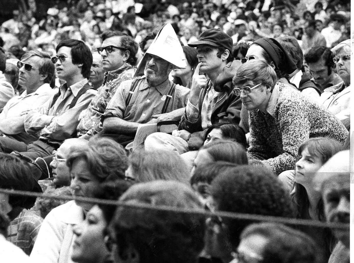 A concertgoer crafted a paper hat to give him relief from the sun at the concert at Sigmund Stern Grove. Photo ran 08/18/1975, P. 3