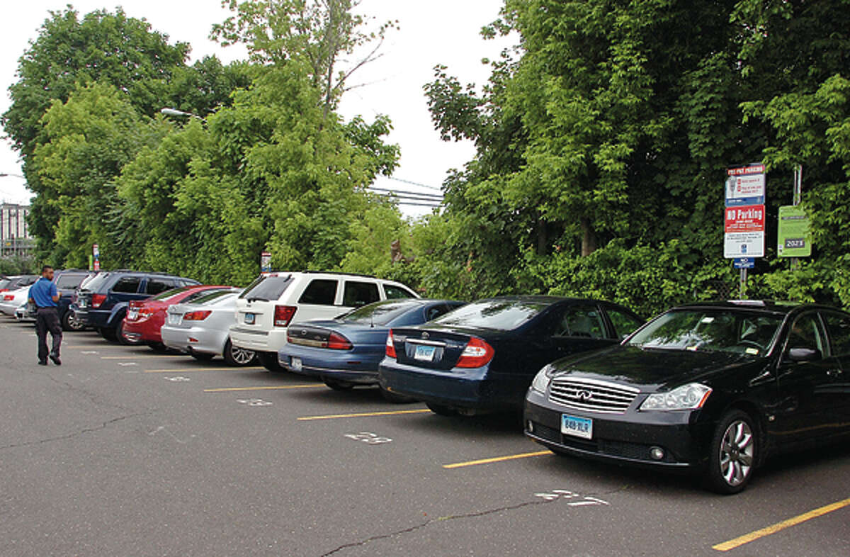 The Norwalk Redevelopment Agency will begin environmental remediation at South Norwalk Train Station in advance of the transit-oriented development. The first phase, slated for this summer, will involve the small parking area on New Haven-bound side and displace 60 parkers to an area of Dr. Martin Luther King Jr. Drive. Hour photo / Erik Trautmann