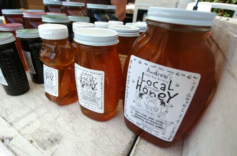 Photo by Alex von Kleydorff. Jars of Andrews Local honey at the Westport farmers market
