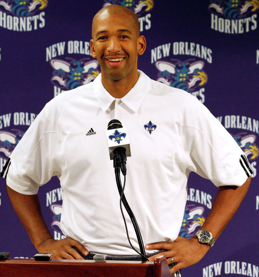 FILE - In this Dec. 17, 2011, file photo, New Orleans Hornets head coach Monty Williams talks to reporters during an NBA basketball news conference in New Orleans. The Hornets won the lottery for the league's No. 1 draft pick, Wednesday, May 30, 2012, in New York. (AP Photo/Jonathan Bachman, File) / AP2011