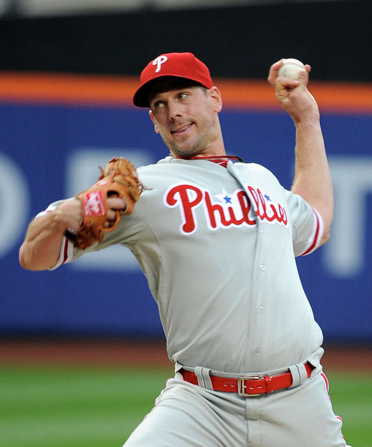 Philadelphia Phillies starting pitcher Cliff Lee throws against the New York Mets in the first inning of a baseball game on Wednesday, May 30, 2012, at Citi Field in New York. (AP Photo/Kathy Kmonicek) / FR170189 AP