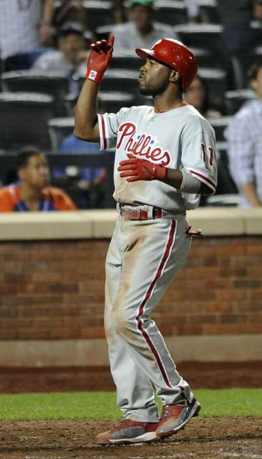 Philadelphia Phillies' Jimmy Rollins points skyward on his way to home plate after hitting a three-run home run off of New York Mets relief pitcher Ramon Ramirez in the ninth inning of a baseball game on Wednesday, May 30, 2012, at Citi Field in New York. (AP Photo/Kathy Kmonicek)