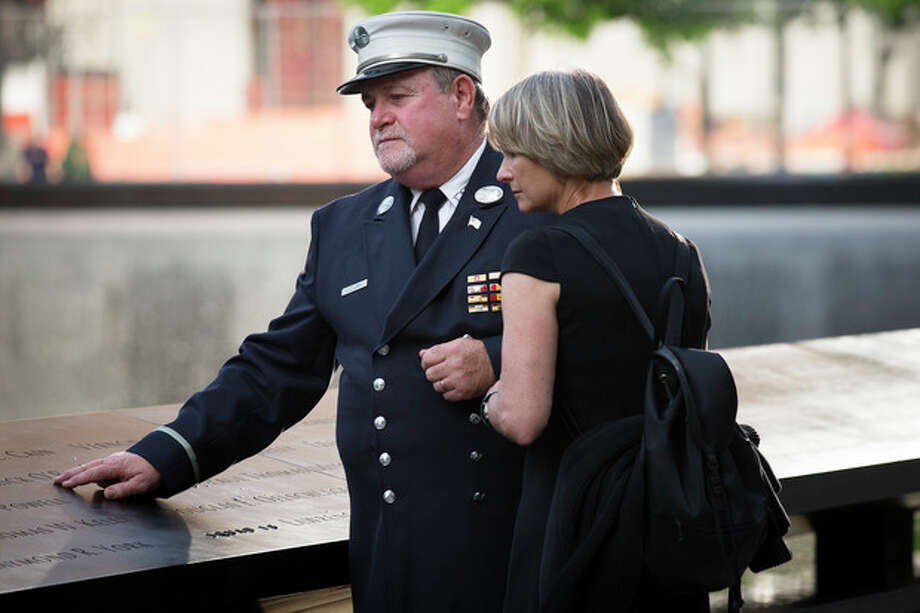 Retired FDNY Lt. Jerry Collins and his wife Suzanne Collins pause at the 9/11 Memorial, Wednesday, May 30, 2012, in New York. Recovery workers and first responders were invited to the memorial to be honored on the 10-year anniversary of the conclusion of clean-up efforts that stretched nine months until May 30, 2002. (AP Photo/John Minchillo) / AP