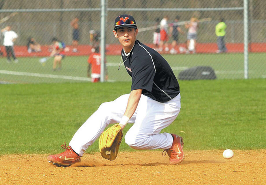 Hour Photo/John Nash Brien McMahon shortstop Bryan Daniello, who will be a senior this year, fields a ground ball during a practice last spring. Soon, heÕll be fielding ground balls for the University of Connecticut baseball program.