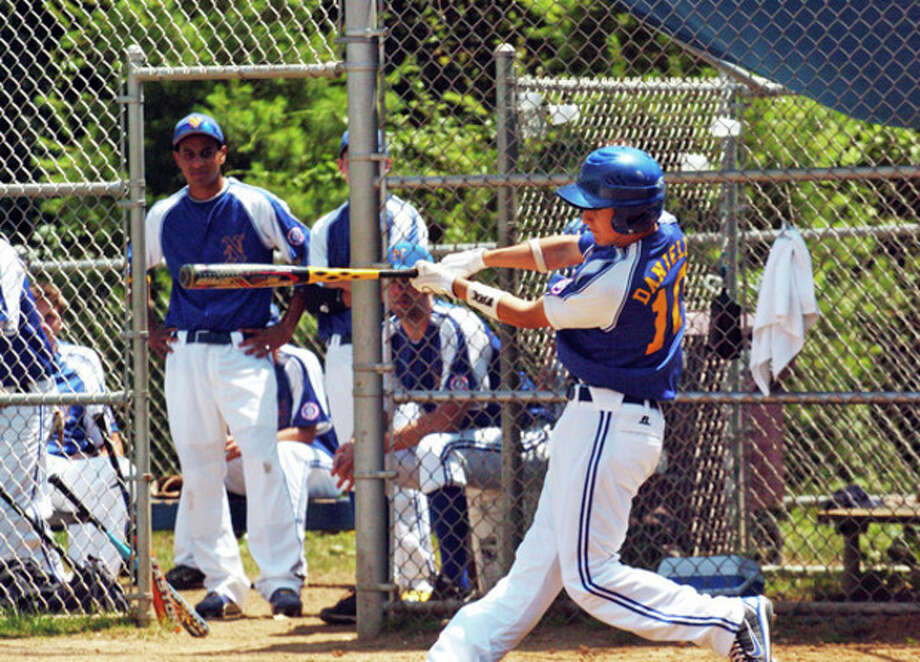 Bryan Daniello, #10 of Norwalk, hits a single in a game against Fairfield during the 2009 15 Year Old Babe Ruth District 2 Tournament Sunday morning at Brien McMahon High School.