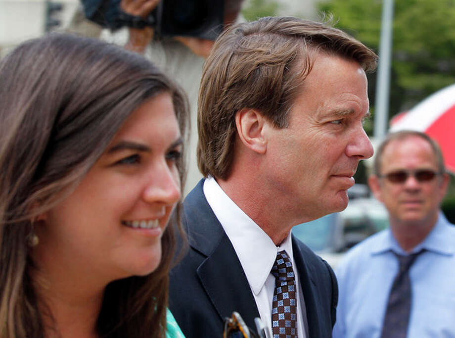 John Edwards, right, and his daughter Cate Edwards, left, arrive at a federal courthouse during the seventh day of jury deliberations in his trial on charges of campaign corruption in Greensboro, N.C., Tuesday, May 29, 2012. Edwards has pleaded not guilty to six counts related to campaign finance violations over nearly $1 million from two wealthy donors used to help hide the Democrat's pregnant mistress as he sought the White House in 2008. (AP Photo/Chuck Burton) / AP