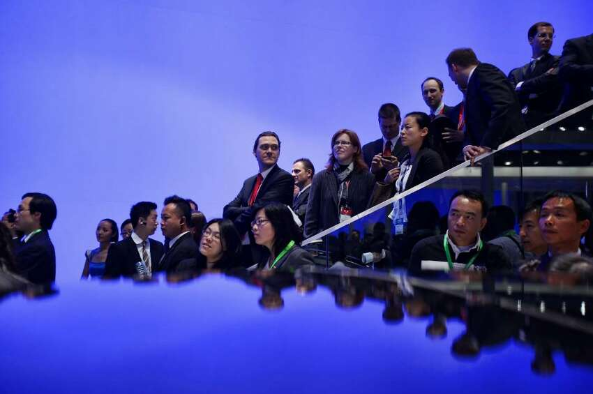 BEIJING - APRIL 23: Visitors wait before a news conference of Volkswagen during a special media opening of the Beijing Auto Show on April 23, 2010 in Beijing of China. Major global automakers plan to unveil dozens of new models at the Beijing auto show, which has quickly become one of the biggest and most important auto shows in the world and raises its curtains on Friday and will last till May 2, during which 990 models - with 89 making their global debut - will be displayed in a 200,000-sq-m area. (Photo by Feng Li/Getty Images)