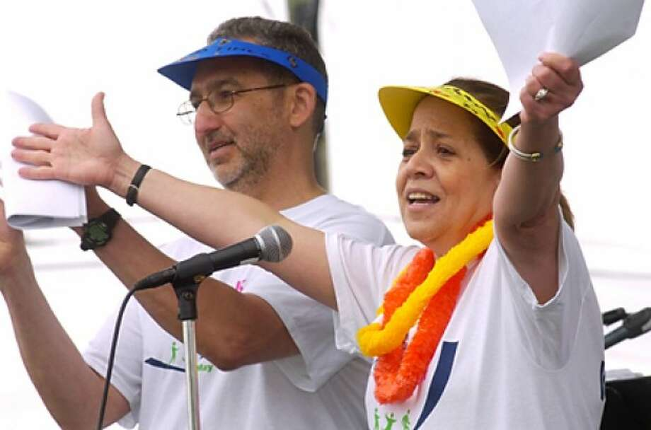 Co-chairs of the Whittingham Cancer Center''s annual 3K walk and 5K, Jeff and Holly Pivor, thank the participants at Norwalk''s Calf Pasture Beach Saturday. Hour photo / Erik Trautmann