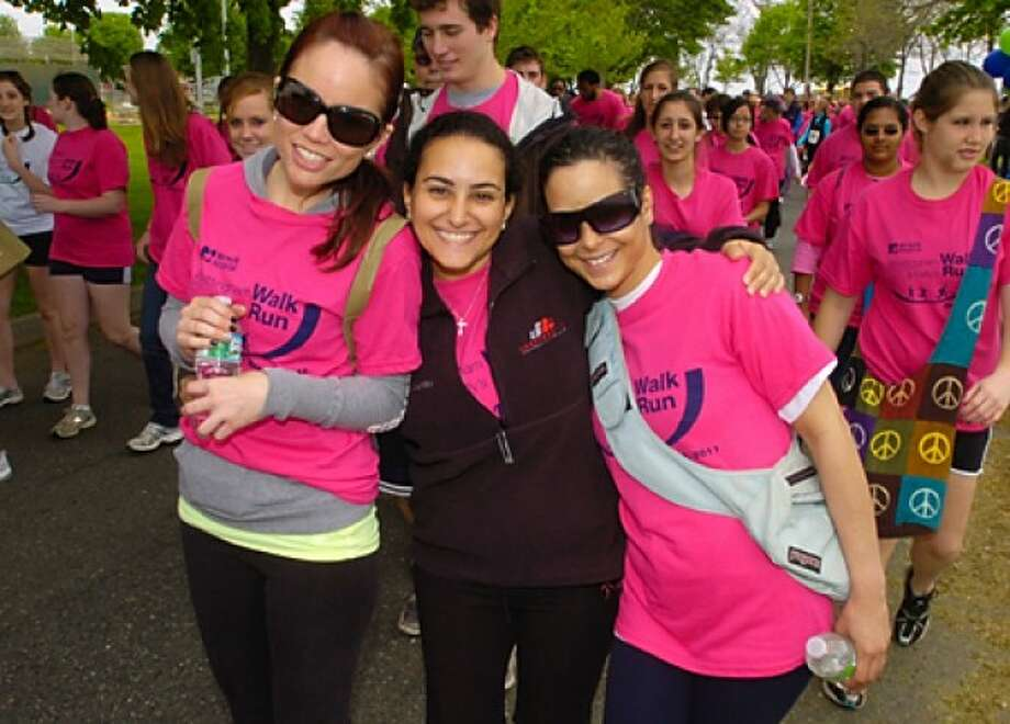 April McKnight, Suzie Elias and Jasmine Crespo paticipate in the Whittingham Cancer Center''s annual 3K walk and 5K run will take place at Norwalk''s Calf Pasture Beach Saturday. Hour photo / Erik Trautmann