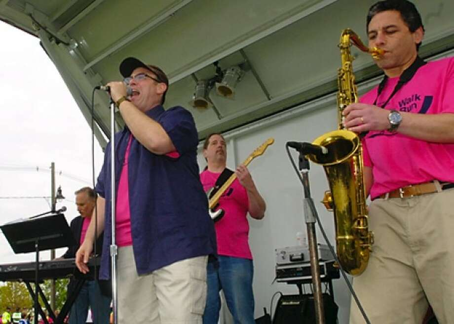 The band DNR, Do Not Resuscitate, whcih is made up of hospital staff play at the Whittingham Cancer Center''s annual 3K walk and 5K run at Norwalk''s Calf Pasture Beach Saturday. Hour photo / Erik Trautmann