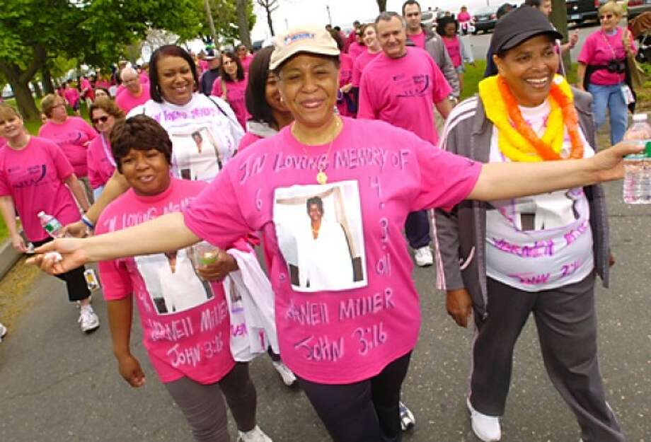 Diane Glee participates in the Whittingham Cancer Center''s annual 3K walk and 5K in memory of Vernell Miller of the Canaan Institutional Baptist Church at Norwalk''s Calf Pasture Beach Saturday. Hour photo / Erik Trautmann