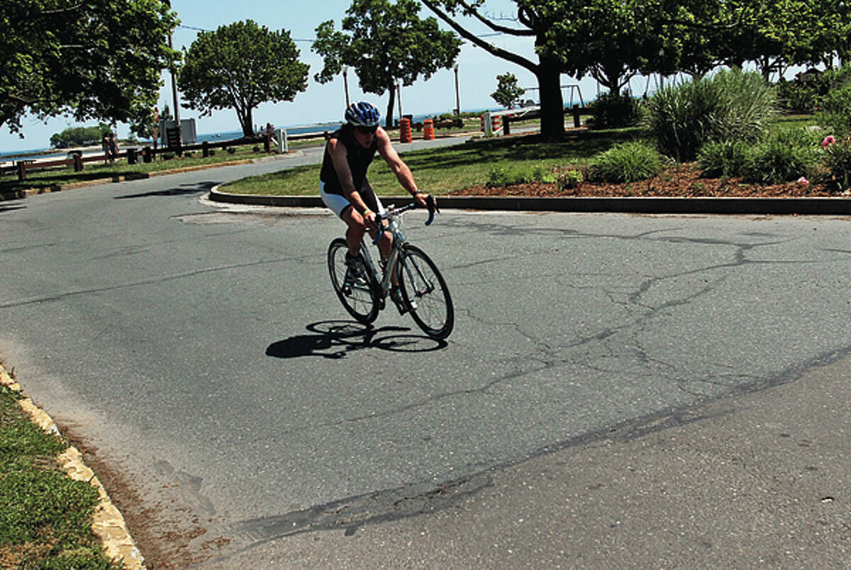 A bicylist exits Calf Pasture Beach onto Calf Pasture Beach Rd. The Common Council's Public Works Committee hears from public on how to improve safety on Calf Pasture Beach Road Thursday night. Hour photo / Erik Trautmann