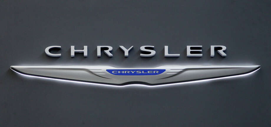 This Feb. 16, 2012 photo shows Chrysler logo on the Chrysler exhibit at the 2012 Pittsburgh Auto Show. Chrysler says its U.S. sales rose 30 percent and sold more than 150,000 vehicles in May, compared with 115,000 in the same month a year ago. (AP Photo/Gene J. Puskar, File) / AP2012
