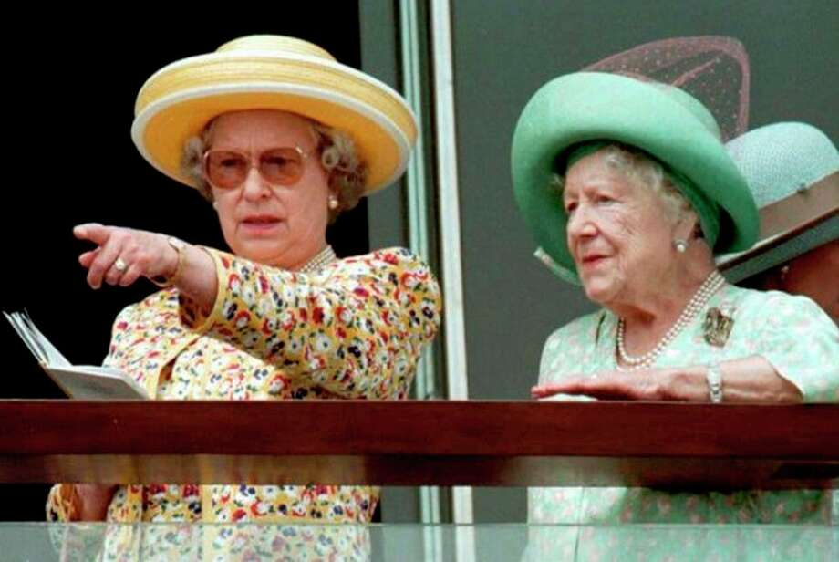 FILE This Saturday June 8 1996, file photo shows Britain's Queen Elizabeth II, left, and Queen Elizabeth the Queen Mother studing the field at Epsom Racecourse, south of London, before the running of the Derby. Queen Elizabeth II kicks off a long weekend of celebrations of her 60-year reign by going to the races, and perhaps no other event will give her so much pleasure. The Epsom Derby is the richest event on Britain's horse-racing calendar, and never mind that this is the only major race in which the queen has never entered a winner. Pleasure, in the gilded life of Queen Elizabeth II, often comes on four hooves. (AP Photo / Roberta Parkin) / PA