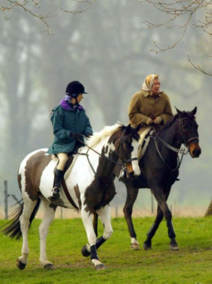 FILE This Tuesday, April 2, 2002 file photo shows Britain's Queen Elizabeth II, right, riding out with Anne, the Princess Royal, at Windsor Castle, England. Queen Elizabeth II kicks off a long weekend of celebrations of her 60-year reign by going to the races, and perhaps no other event will give her so much pleasure. The Epsom Derby is the richest event on Britain's horse-racing calendar, and never mind that this is the only major race in which the queen has never entered a winner. Pleasure, in the gilded life of Queen Elizabeth II, often comes on four hooves.(AP Photo/Alastair Grant)
