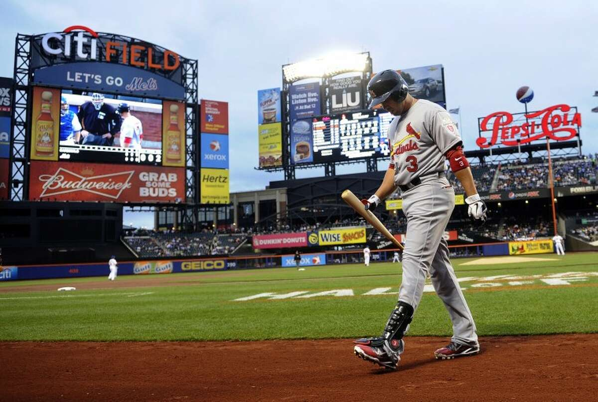 St. Louis Cardinals' Carlos Beltran walks back to the dugout after striking out for his first at-bat off New York Mets starting pitcher Johan Santana in the first inning of a baseball game on Friday, June 1, 2012, at Citi Field in New York. (AP Photo/Kathy Kmonicek)