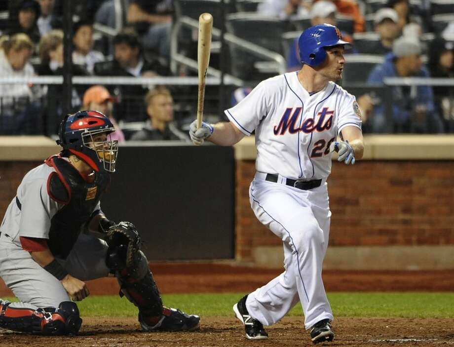 New York Mets' Daniel Murphy (28) hits an RBI-triple off St. Louis Cardinals starting pitcher Adam Wainwright in the fourth inning of a baseball game on Friday, June 1, 2012, at Citi Field in New York. (AP Photo/Kathy Kmonicek)