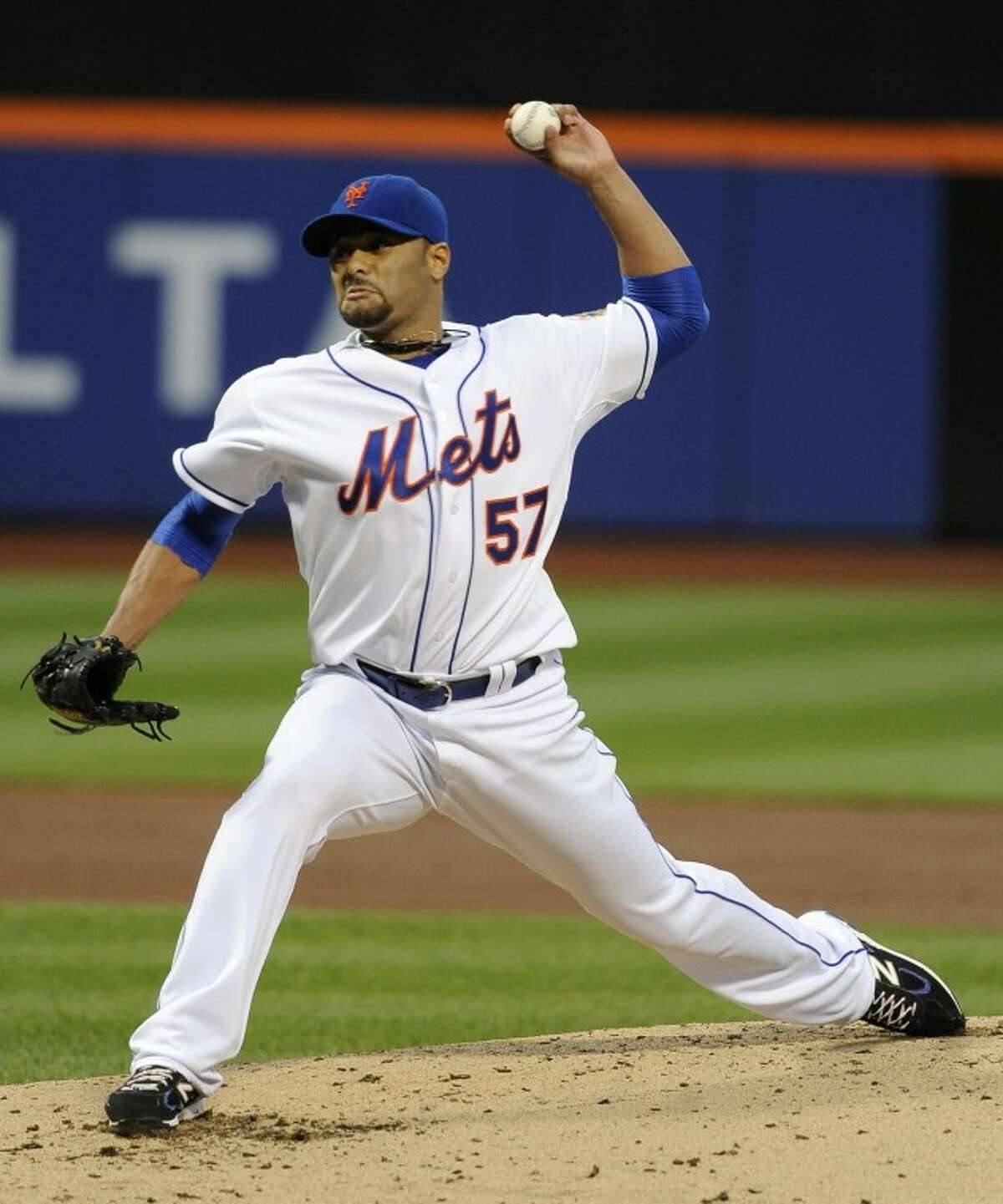 New York Mets starting pitcher Johan Santana (57) throws against the St. Louis Cardinals in the second inning of a baseball game on Friday, June 1, 2012, at Citi Field in New York. (AP Photo/Kathy Kmonicek)
