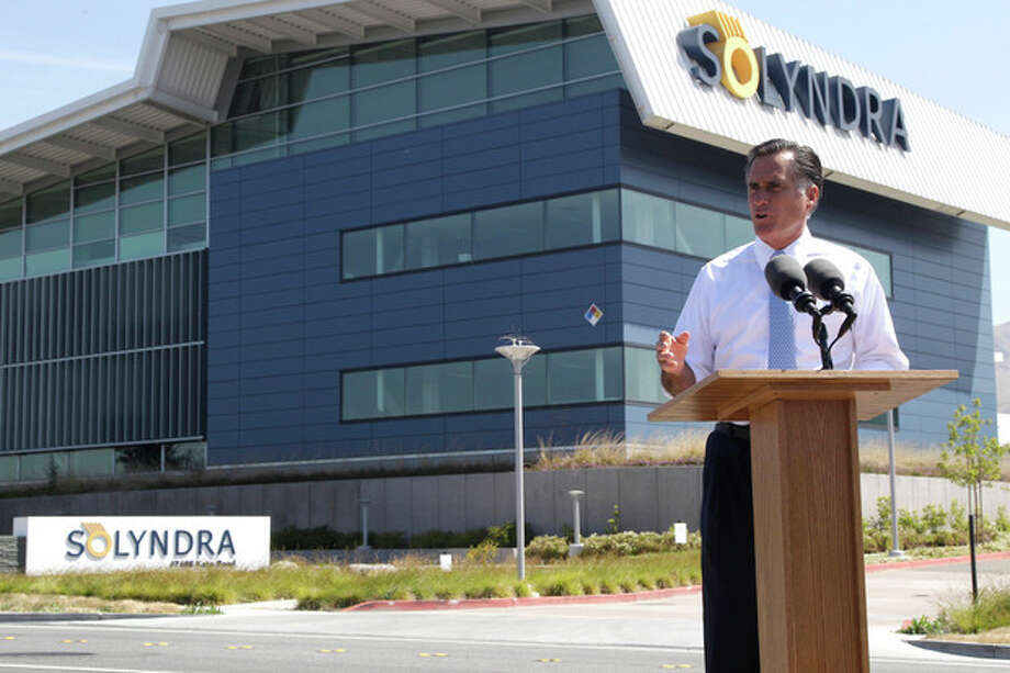 FILE - In this May 31, 2012 file photo, Republican presidential candidate, former Massachusetts Gov. Mitt Romney holds a news conference outside the Solyndra manufacturing facility in Fremont, Calif. Mitt Romney mischaracterized an Energy Department Inspector General investigation when he claimed it found the Obama administration had steered federal contracts to friends and family at Solyndra, the California solar company that went bankrupt. (AP Photo/Mary Altaffer, File) / AP