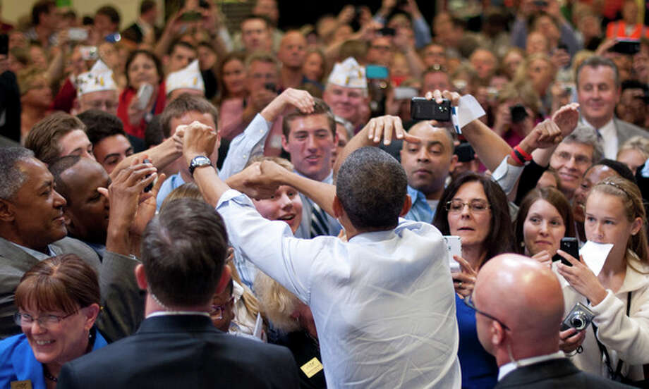 President Barack Obama greets supporters after speaking about jobs for veterans, Friday, June 1, 2012, at Honeywell Automation and Control Solutions Global Headquarters in Golden Valley, Minn. (AP Photo/The Star Tribune, Glen Stubbe, Pool) / Pool The Star Tribune