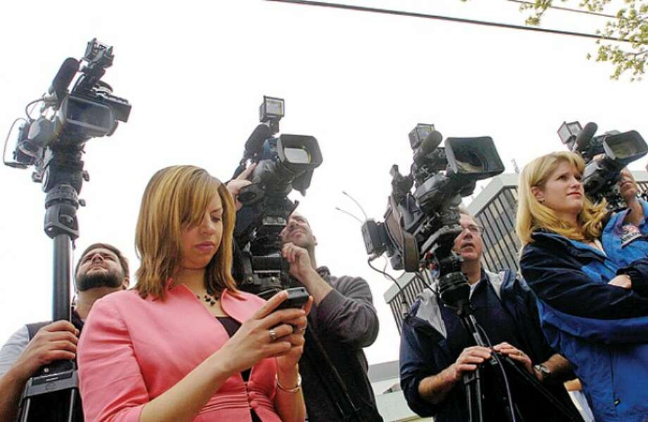 The press gathers for a press conference for Tanya McDowell, who was arrested and charged with larceny and conspiracy to commit larceny for allegedly stealing $15,686 from Norwalk schools after she enrolled her son the Norwalk Public Schools, outside Norwalk Superior Court Wednesday morning. Hour photo / Erik Trautmann