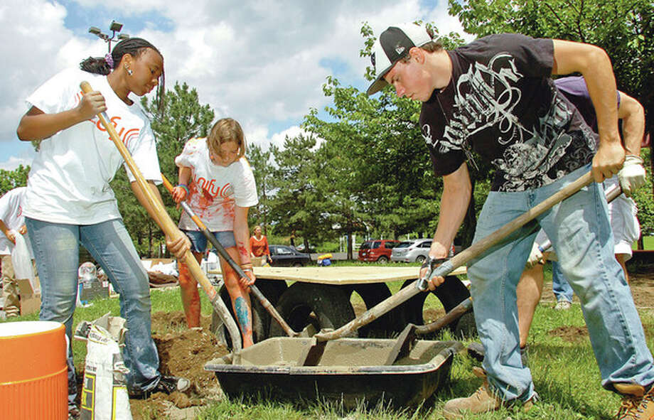 "Brianna Green, Sophie Thompson and James Fleming from Grace Community Church join the Norwalk faith community in the 2nd Annual ""Unify for Nowalk Day"" where different church groups from around Norwalk helped clean up Ryan Park Saturday.Hour photo / Erik Trautmann / (C)2012, The Hour Newspapers, all rights reserved"