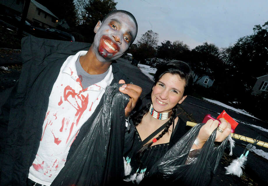 Lavon Williams, 15, and Ianina Rodas, 14, trick or treat in Norwalk Monday night. / (C)2011, The Hour Newspapers, all rights reserved