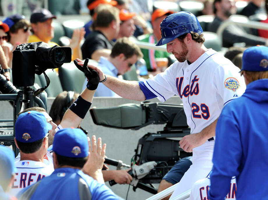 New York Mets' Ike Davis (29) is greeted at the dugout after scoring on Andres Torres's ground out in the second inning of a baseball game against the St. Louis Cardinals on Saturday, June 2, 2012, at Citi Field in New York. (AP Photo/Kathy Kmonicek) / FR170189 AP