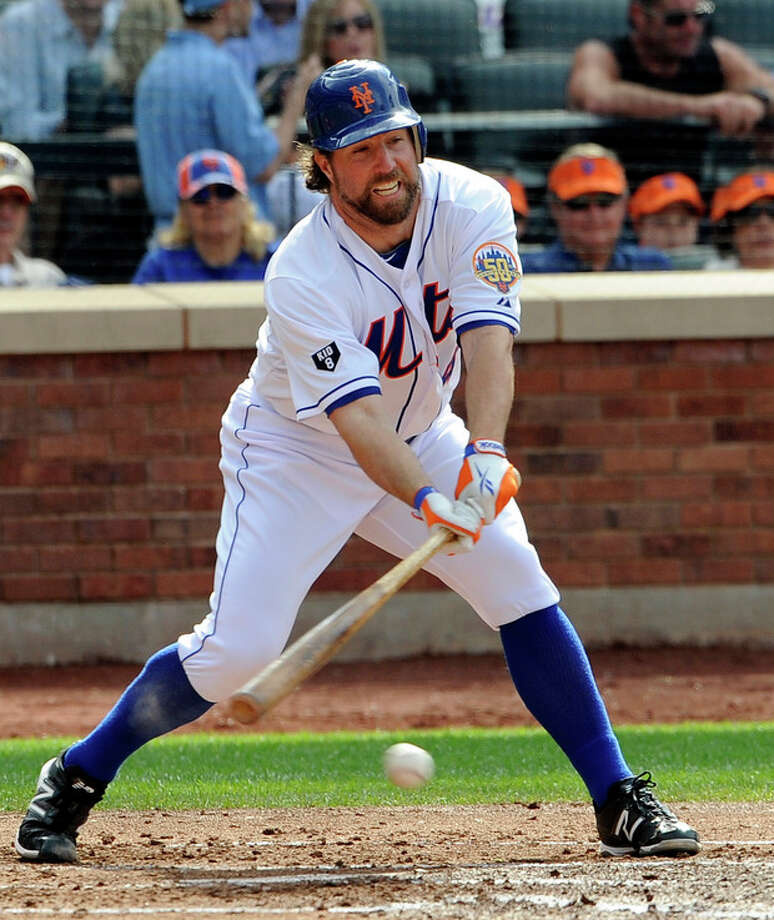 New York Mets' R.A. Dickey bats during the second inning of a baseball game against St. Louis Cardinals on Saturday, June 2, 2012, at Citi Field in New York. Dickey reached first base safely oCardinals first baseman Matt Adams fielding error that also allowed Ike Davis to score. (AP Photo/Kathy Kmonicek) / FR170189 AP