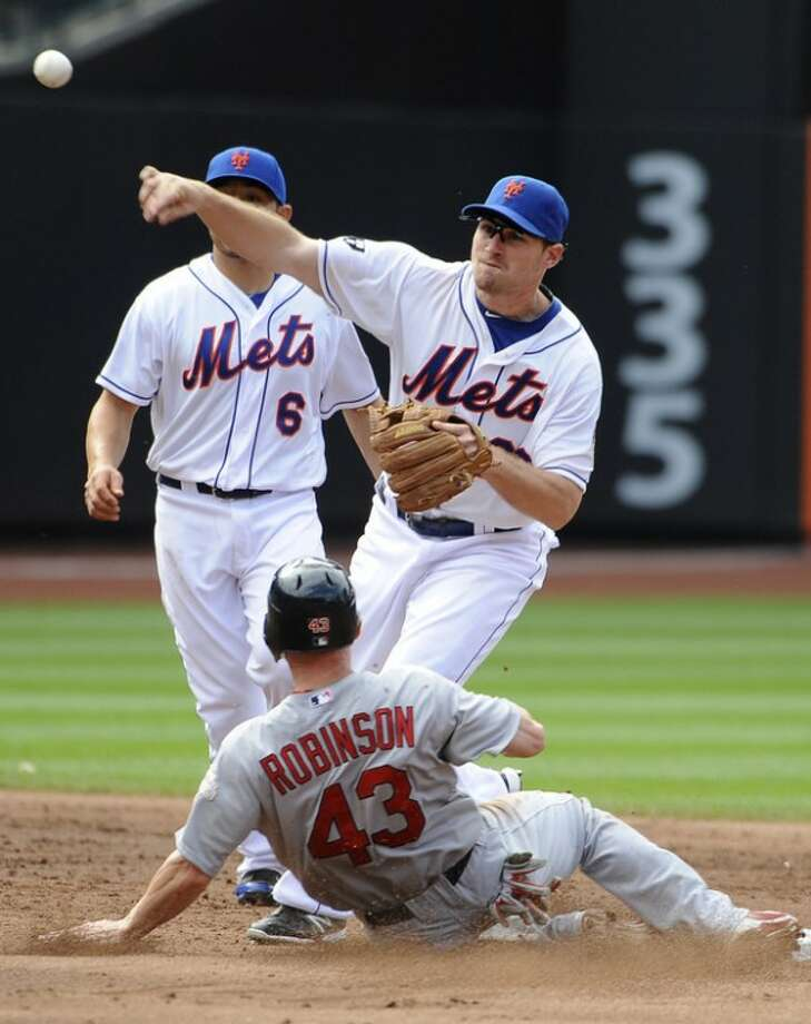 New York Mets second baseman Daniel Murphy (28) forces out St. Louis Cardinals' Shane Robinson (43) at second base and throws to first base for the double play in the fourth inning of a baseball game on Saturday, June 2, 2012, at Citi Field in New York. (AP Photo/Kathy Kmonicek)