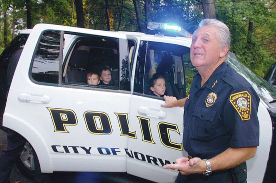 Hour photo / Erik Trautmann A police escort to school Norwalk Police Chief Rilling picks up the three Martyn children, Gaspard, Marius and Ciara, at their home and brings them to Side by Side Charter School Thursday morning. The special trip was won by the Martyn family as a unique auction item at the school's Annual Gala and Silent Auction last spring. / (C)2011, The Hour Newspapers, all rights reserved