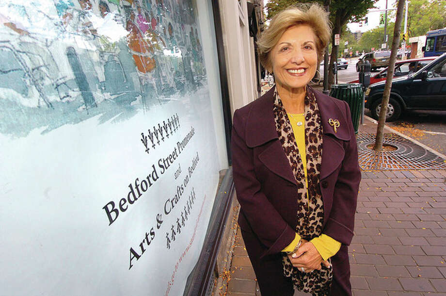 Photo by Alex von Kleydorff. Sandy Goldstein, president of the Stamford Downtown Special Services District (DSSD), in front of an empty storefront on Bedford Street in Stamford. A renewed DSSD promotion, the Retail Advancement Program, is offering retailers incentives to settle in downtown Stamford. / 2011 The Hour Newspapers/ Alex von Kleydorff