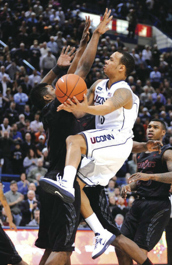 AP photoUConn's Shabazz Napier, driving to the basket during a Feb. 21 game against Cincinnati, has been named to the All-Big East first team.