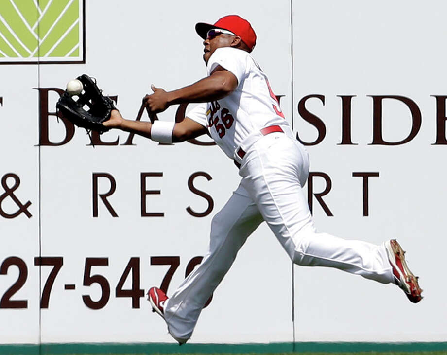 St. Louis Cardinals left fielder Adron Chambers catches a ball hit by New York Mets' Omar Quintanilla for an out during the third inning of an exhibition spring training baseball game Sunday, March 10, 2013, in Jupiter, Fla. Chambers was able to double up the Mets Landon Powell when he couldn't get back to first on the play. (AP Photo/Jeff Roberson) / AP