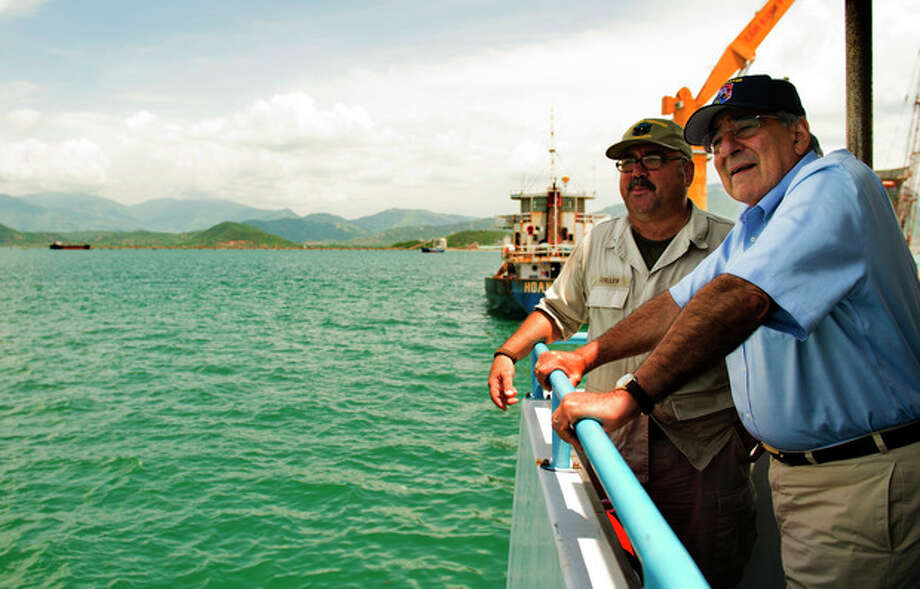 U.S. Secretary of Defense Leon Panetta, right, talks with Chief Mate Fred Cullen as he takes a boat out to a U.S. navy cargo ship USNS Richard E. Byrd in Cam Ranh Bay, Vietnam, Sunday, June 3, 2012. (AP Photo/Jim Watson, Pool) / POOL AFP