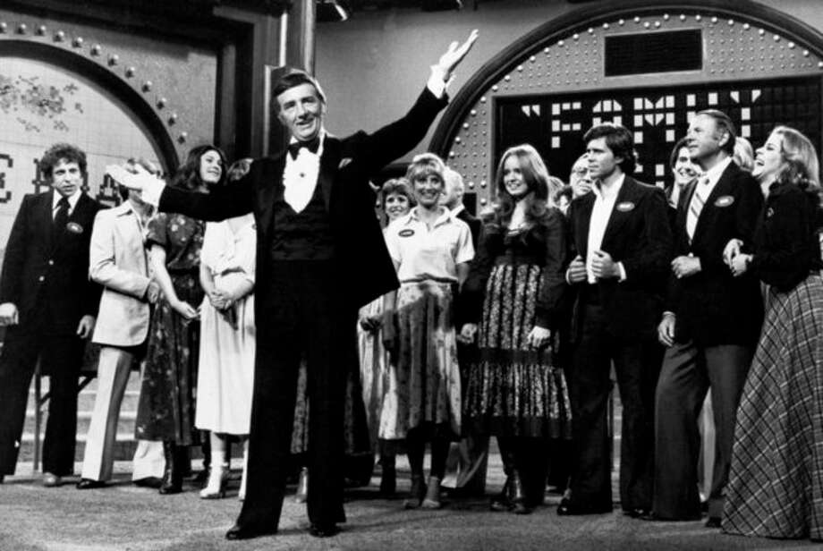 "FILE - In this May 8, 1978 file photo, Richard Dawson, foreground, is in his familiar role as host of ""Family Feud"" when the casts of ABC's comedy series ""Eight is Enough,"" ""The Love Boat,"" ""Soap,"" and ""Three's Company"" compete to benefit charity. Dawson, the wisecracking British entertainer who was among the schemers in the 1960s sitcom ""Hogan's Heroes"" and a decade later began kissing thousands of female contestants as host of the game show ""Family Feud"" died Saturday, June 2, 2012. He was 79. (AP Photo, File) / AP2006"