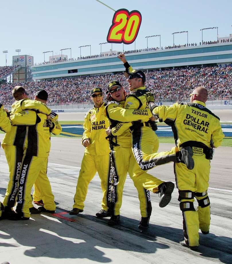 Pit crew members for Matt Kenseth celebrate after he won the NASCAR Sprint Cup Series auto race, Sunday, March 10, 2013 in Las Vegas. (AP Photo/Julie Jacobson) / AP