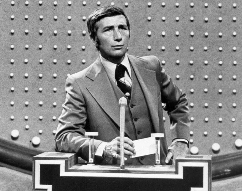 "FILE - This June 1978 file photo shows Richard Dawson, host of ""Family Feud"" in character. Dawson, the wisecracking British entertainer who was among the schemers in the 1960s sitcom ""Hogan's Heroes"" and a decade later began kissing thousands of female contestants as host of the game show ""Family Feud"" died Saturday, June 2, 2012. He was 79. (AP Photo, File) / AP2006"