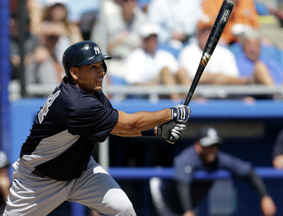 New York Yankees' Juan Rivera hits a fifth-inning three-run double off Toronto Blue Jays pitcher Brett Cecil in a spring training baseball game at Steinbrenner Field in Dunedin, Fla., Sunday, March 10, 2013. (AP Photo/Kathy Willens) / AP