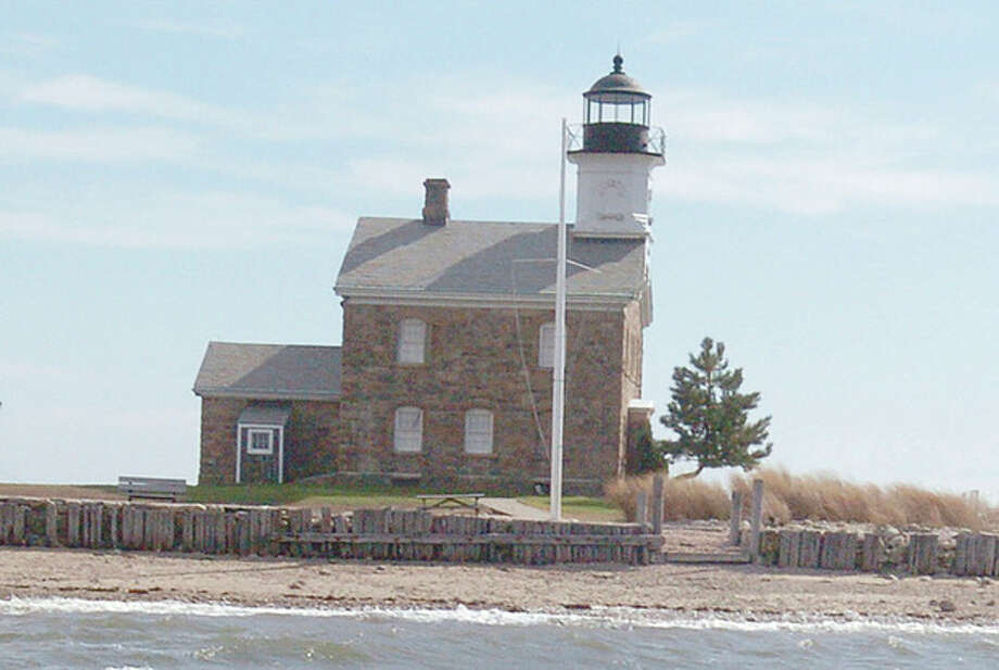 Hour photo / Matthew Vinci Sheffield Island Lighthouse seen from the rocky waters of Long Island Sound Sunday. / (C)2011, The Hour Newspapers, all rights reserved