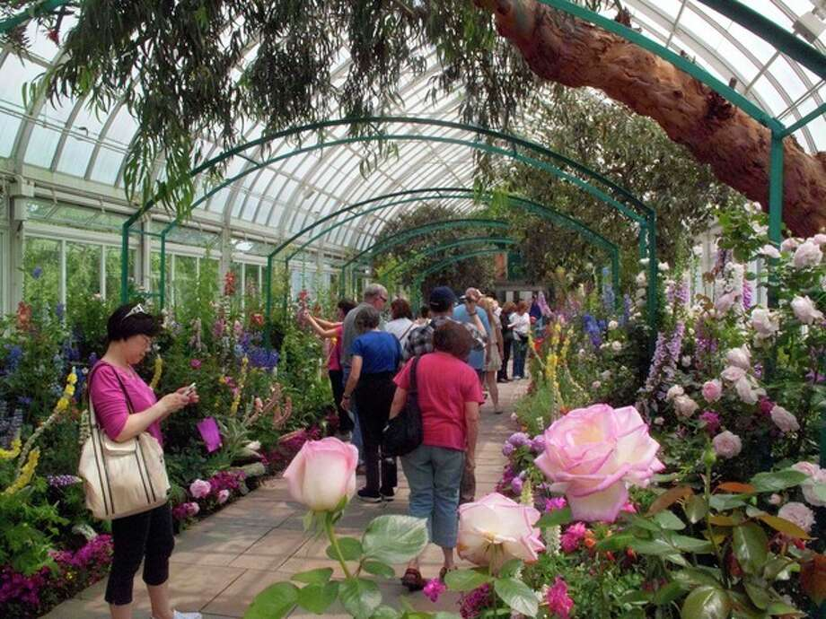 "In this May 26, 2012 photo, visitors to the New York Botanical Garden in New York walk through ""Monet's Garden,"" which evokes the impressionist artist Claude Monet's garden at Giverny, his home in France, from 1883 until his death in 1926. The exhibit runs through Oct. 21. (AP Photo/Ray Stubblebine) / AP"