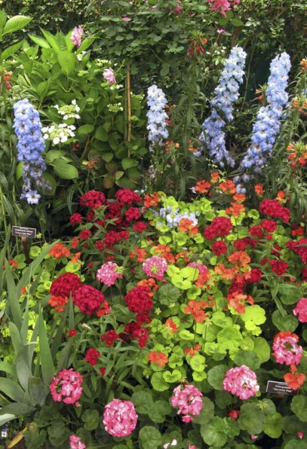 "In this May 26, 2012 photo, a display of flowers is seen in ""Monet's Garden,"" at the New York Botanical Garden in New York. The exhibit, which evokes the impressionist artist Claude Monet's garden at Giverny, his home in France from 1883 until his death in 1926, runs through Oct. 21. (AP Photo/Ray Stubblebine)"