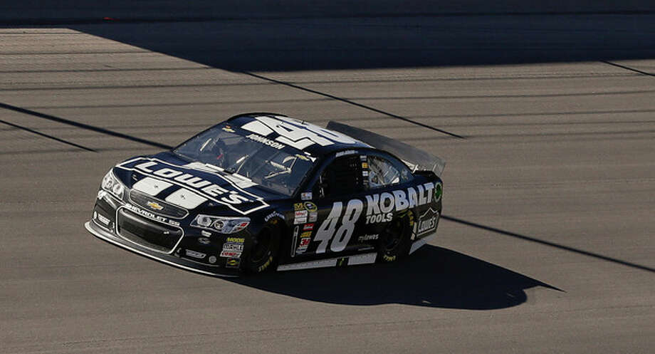 Jimmie Johnson leads the pack early during the NASCAR Sprint Cup Series auto race, Sunday, March 10, 2013 in Las Vegas. (AP Photo/Julie Jacobson) / AP