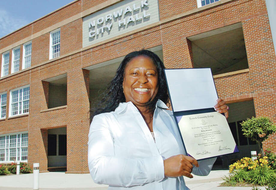 Hour photo / Erik TrautmannSally Johnson, Executive Assistant to the Mayor, has earned her degree at Norwalk Community College and graduated last month. / (C)2012, The Hour Newspapers, all rights reserved