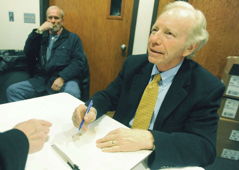 "U.S. Sen. Joe Lieberman at Congregation Agudath Sholom in Stamford, where he signed his book Sunday, ""The Gift of Rest, Rediscovering the Beauty of the Sabbath."" hour photo/Matthew Vinci / (C)2011, The Hour Newspapers, all rights reserved"