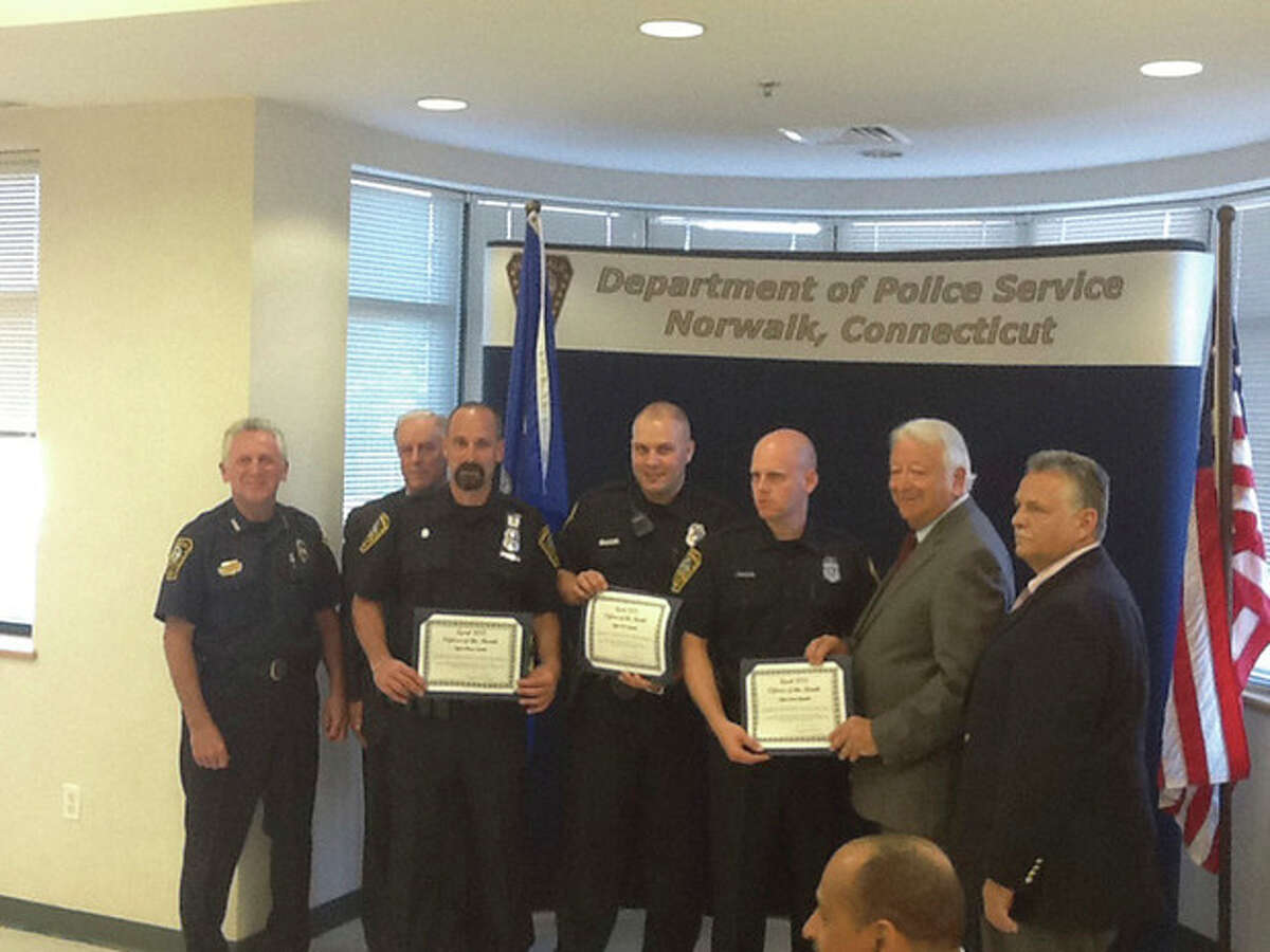 Contributed photo Officers Julio Rodriguez, Jared Zwickler, Kyle Lipeika and Bruce Lovallo were given the Officer of the Month award, Thursday.