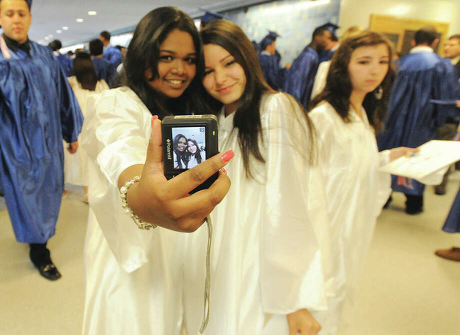 Sandra Joseph and Maribel Cardenas at the Brien McMahon graduation. hour photo/matthew vinci