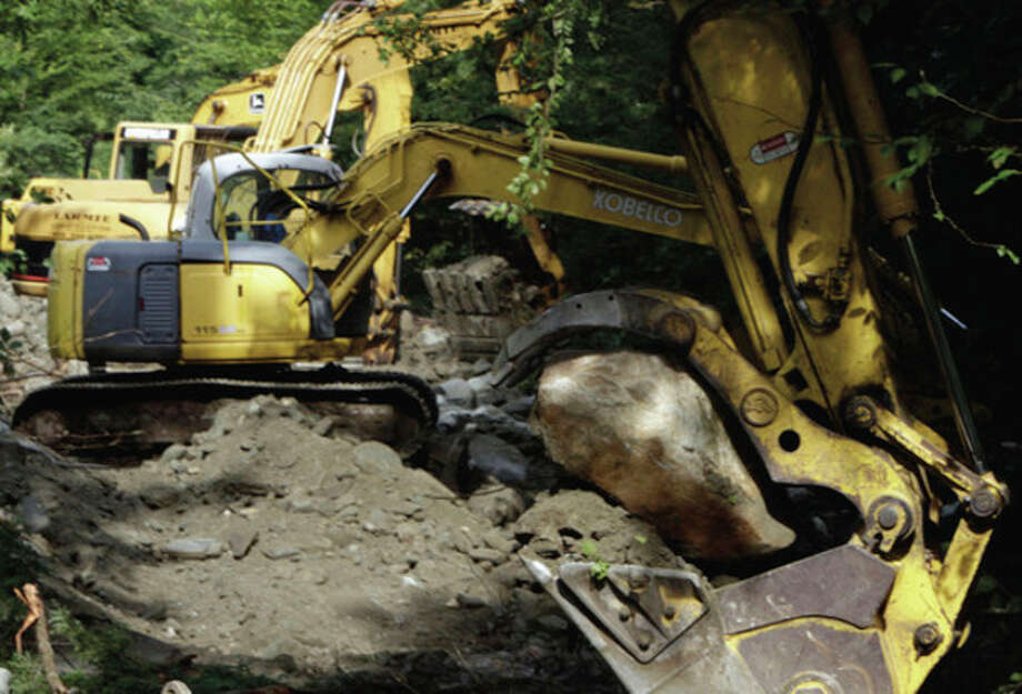Excavators line up to redig the stream bed near Camp Brook Rd. on Wednesday, Aug. 31, 2011 in Bethel, Vt. (AP Photo/Toby Talbot) / AP