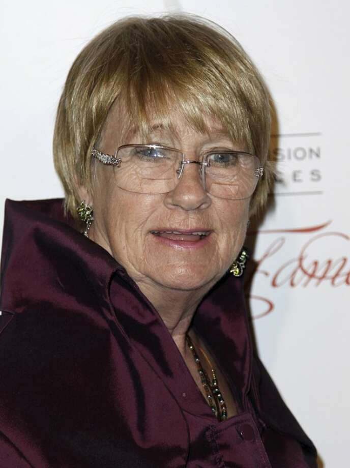 "In this March 1, 2012 photo, Kathryn Joosten arrives at the Academy of Television Arts and Sciences 21st Annual Hall of Fame Gala in Beverly Hills, Calif. Joosten, a veteran character actress who played the crotchety, nosey Karen McCluskey on ABC's ""Desperate Housewives,"" has died. She was 72. Publicist Nadine Jolson said Joosten, who had battled lung cancer for years, died Saturday, June 2, 2012, in Los Angeles. (AP Photo/Matt Sayles)"