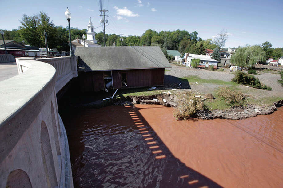 A house rests against a bridge after floating down the Batavia Kill stream after Tropical Storm Irene flooded parts of the town, Tuesday, Aug. 30, 2011 in Windham, N.Y. Officials say more than a dozen towns in Vermont and at least three in New York are cut off, with roads and bridges washed out by flooding caused by the remnants of Hurricane Irene. In New York, the towns of Keene in the Adirondacks, and Windham and Phoenicia in the Catskills are effectively isolated by damage to roads and bridges. (AP Photo/Mary Altaffer) / AP